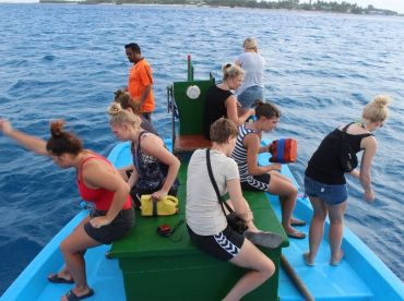 Guests trying their luck in reef fishing.