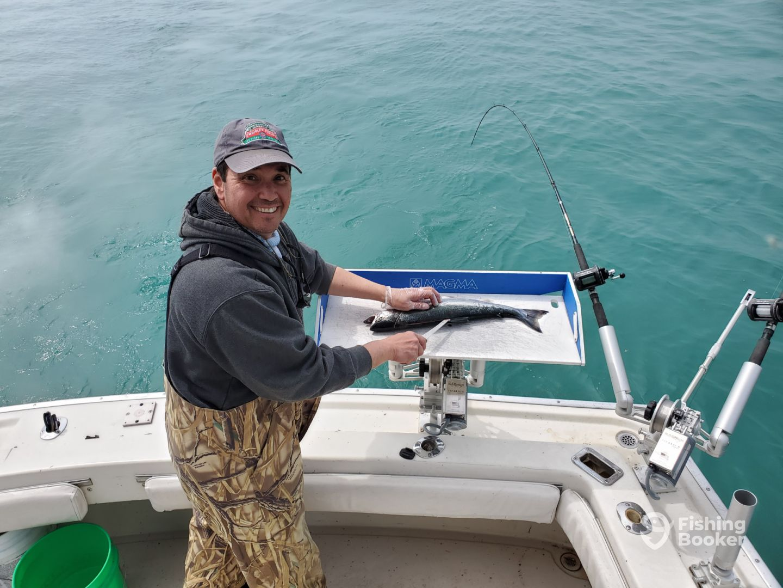 Captain Joe cleaning the Coho Salmon