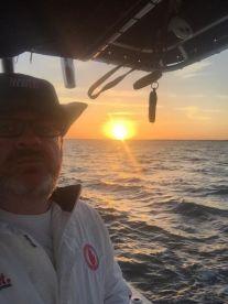 picking up bait at sunrise