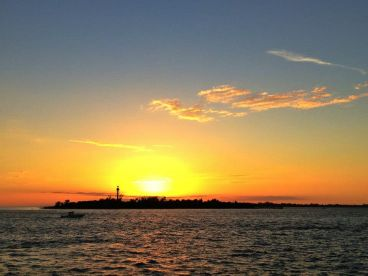 Sunset cruise by the Sanibel light house.