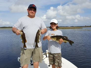 Father takes his son fishing for the first time. Not a bad catch!
