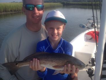 8 lb Redfish caught by this happy young man