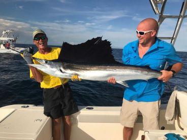 Capt. Tim and David Fuller with a big Sailfish