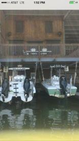 My 24ft Key West to the right docked under condo for fishing trips.
