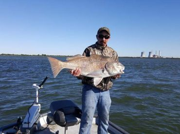 This is a 56lb black drum that Josh caught with me on his first trip out with Reel Time Outfitter