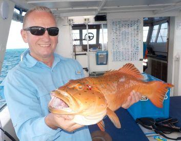 Bar cheek Coral Trout and happy angler