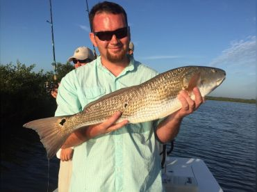 Another happy client with a nice Mosquito Lagoon redfish.