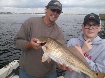 Capt. Joe with a young angler and a nice Redfish
