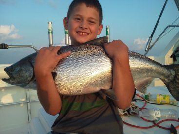 Kid loves hugging those King Salmon