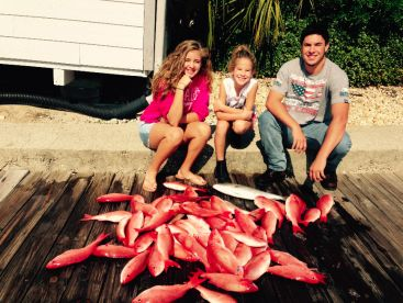 A nice family trip yields a nice catch of Snapper.