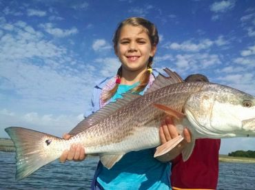 little girl big redfish