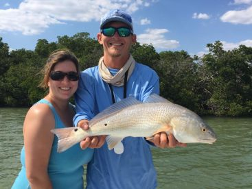 Captain Josh Roberts with a nice Estero Bay Redfish