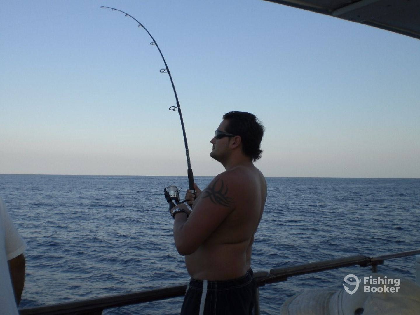 Man fighting his trophy. He landed a beautiful sailfish