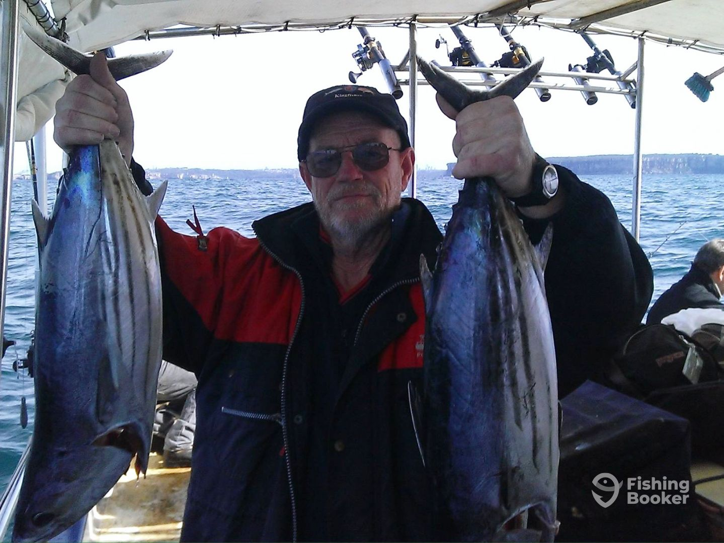 Captain Colin with a pair of Bonito on the lures