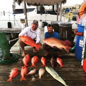 Capt. Johnathon and 1st Mate Travis with a. I've haul!