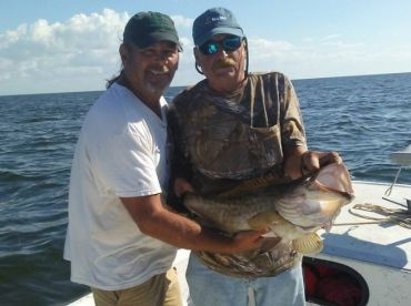 Happy fishermen with a nice 29 inch gag grouper.
