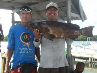 Captain Bicho and Bicho Jr with a nice Grouper!!!
