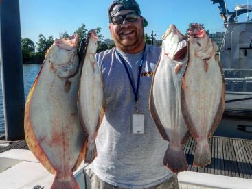 Capt. with a couple fistfuls of Fluke