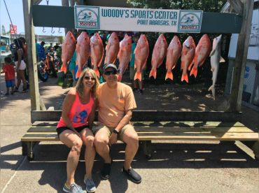 Owners Kyle and Charla with their catch