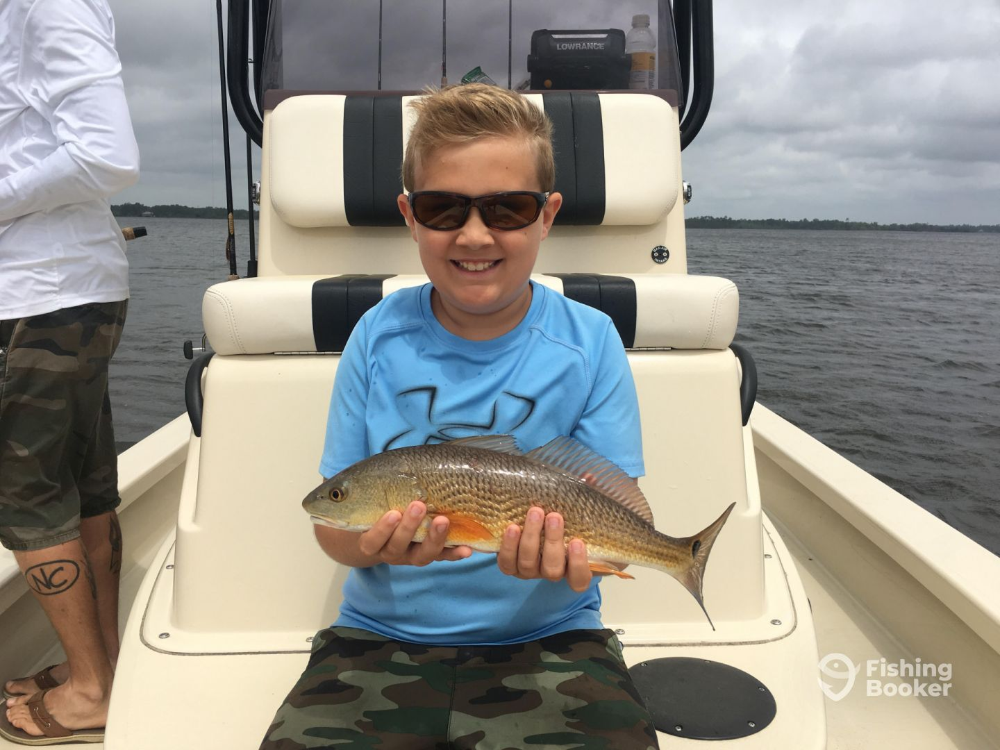 Masen with a nice redfish he caught throwing Gulp!