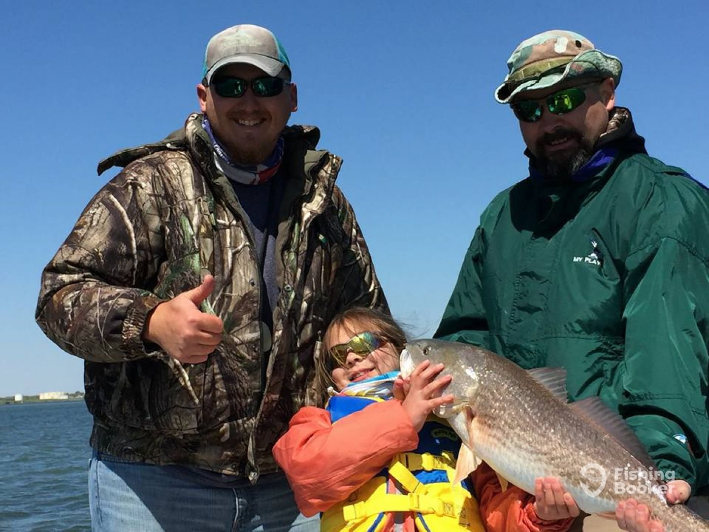 First redfish for this happy little customer!