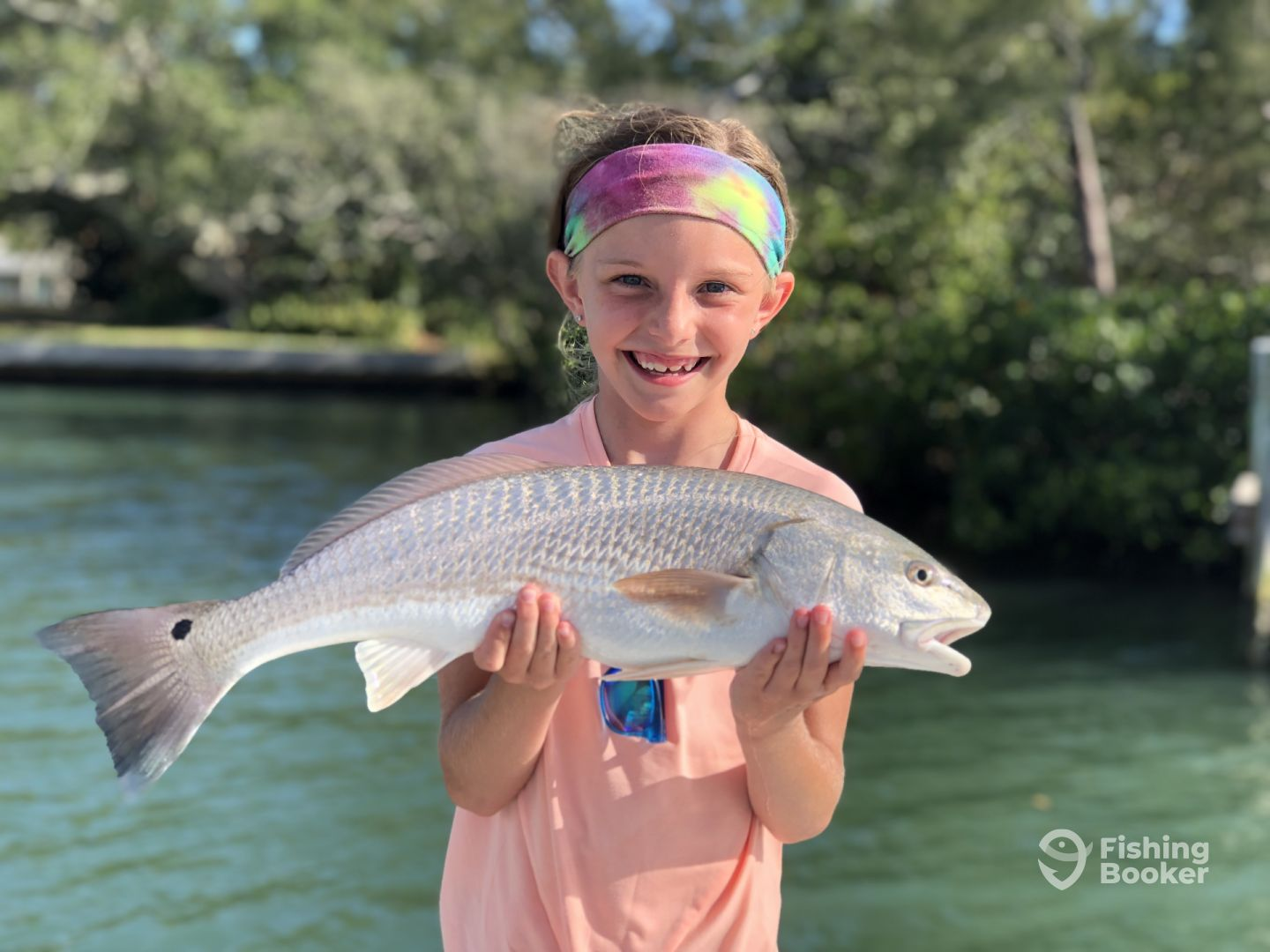 Young angler with a reat Redfish