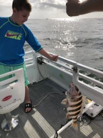 Our 10 year old nephew catches a sheepshead
