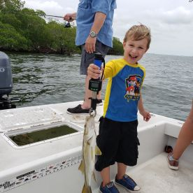 Grandson catching his first snook