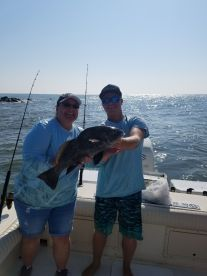 Dana with the black drum assisted by Zack.