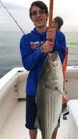 50 lbs striped bass caught by my 15yr old son!!