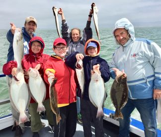 The Wieland family with combo of halibut & bass