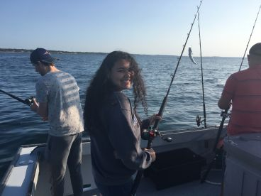 Captain Frank and First Mate John fishing for Striped Bass.
