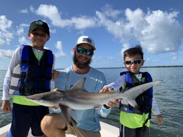He wanted to catch a shark and the Capt. delivered