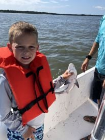 Getting to hold his first shark!