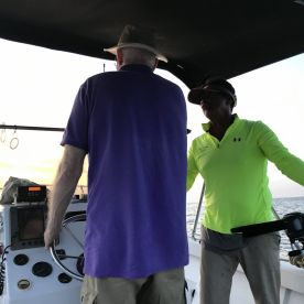 Tom steers while Captain Hollywood sets our rods.