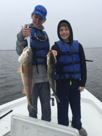 """Shep and Carter with a bull redfish and 21"""" trout"""