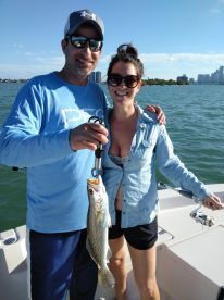 Sean be with Eva catching speckled Sea troutp
