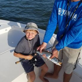 Captain Brad helped the boys catch a bunch of fish