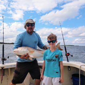 Grandson Jack reels in a nice bull redfish!